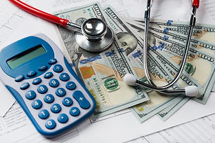 Health care costs. Stethoscope and calcu