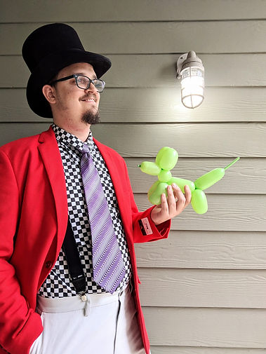 Balloon artist | balloon man | trendy coat | balloon dog | spiffy | checkers | red jacket | suspenders | san antonio balloon artist|