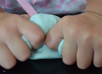The benefits of playing with play dough and 5 fun play dough activities.