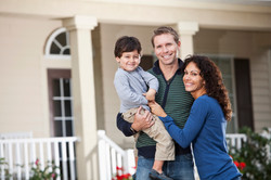 Family-of-three-In-front-home