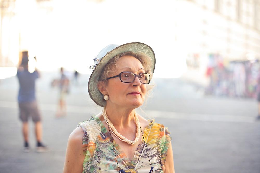 Women wearing a hat looking off in distance