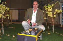 Vitirover inventor with his robot