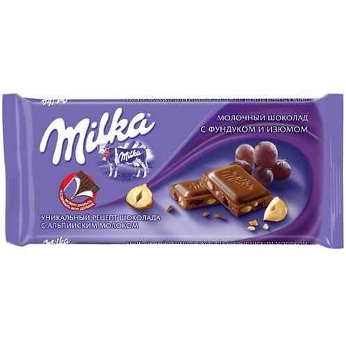 Шоколад Милка  фундук-изюм  90гр 1шт. оптом