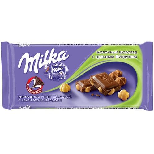 Шоколад Милка  фундук (цельный)  90гр 1шт. оптом