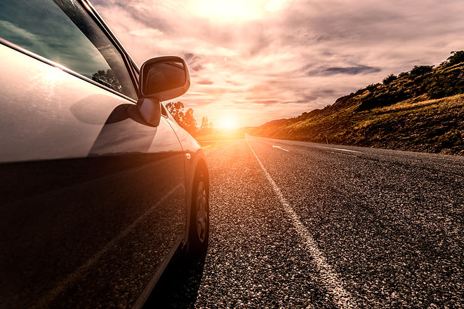 car-travelling-by-sunny-road.jpg