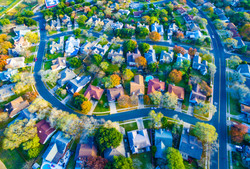 Aerial View Over Modern Suburb Home Comm