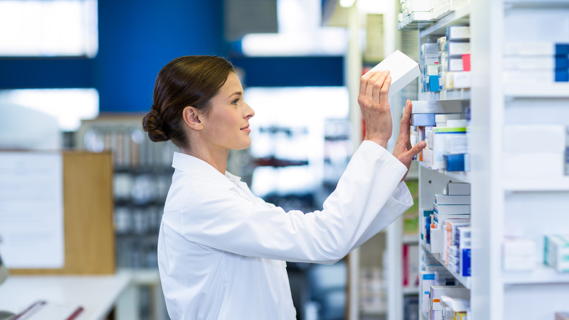pharmacist-checking-medicine-in-shelf-SB