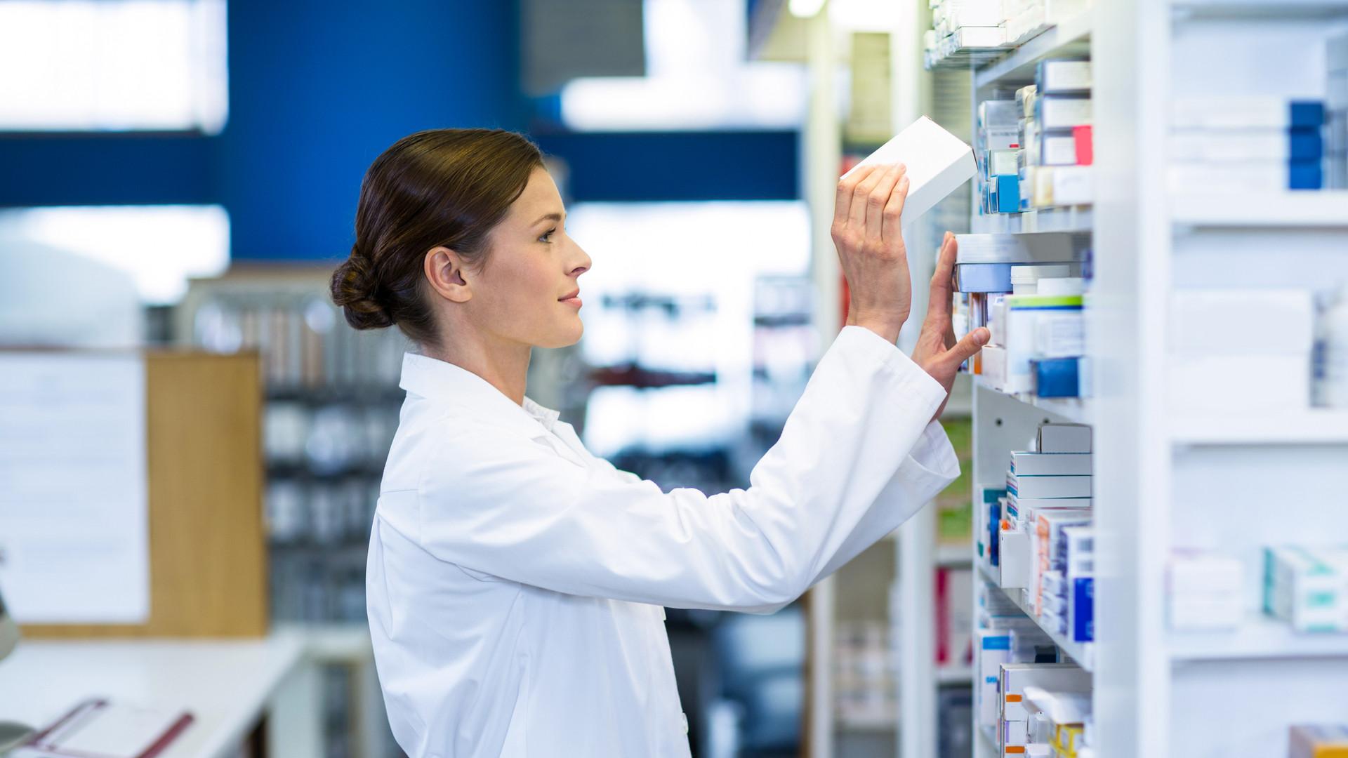 pharmacist-checking-medicine-in-shelf-SB