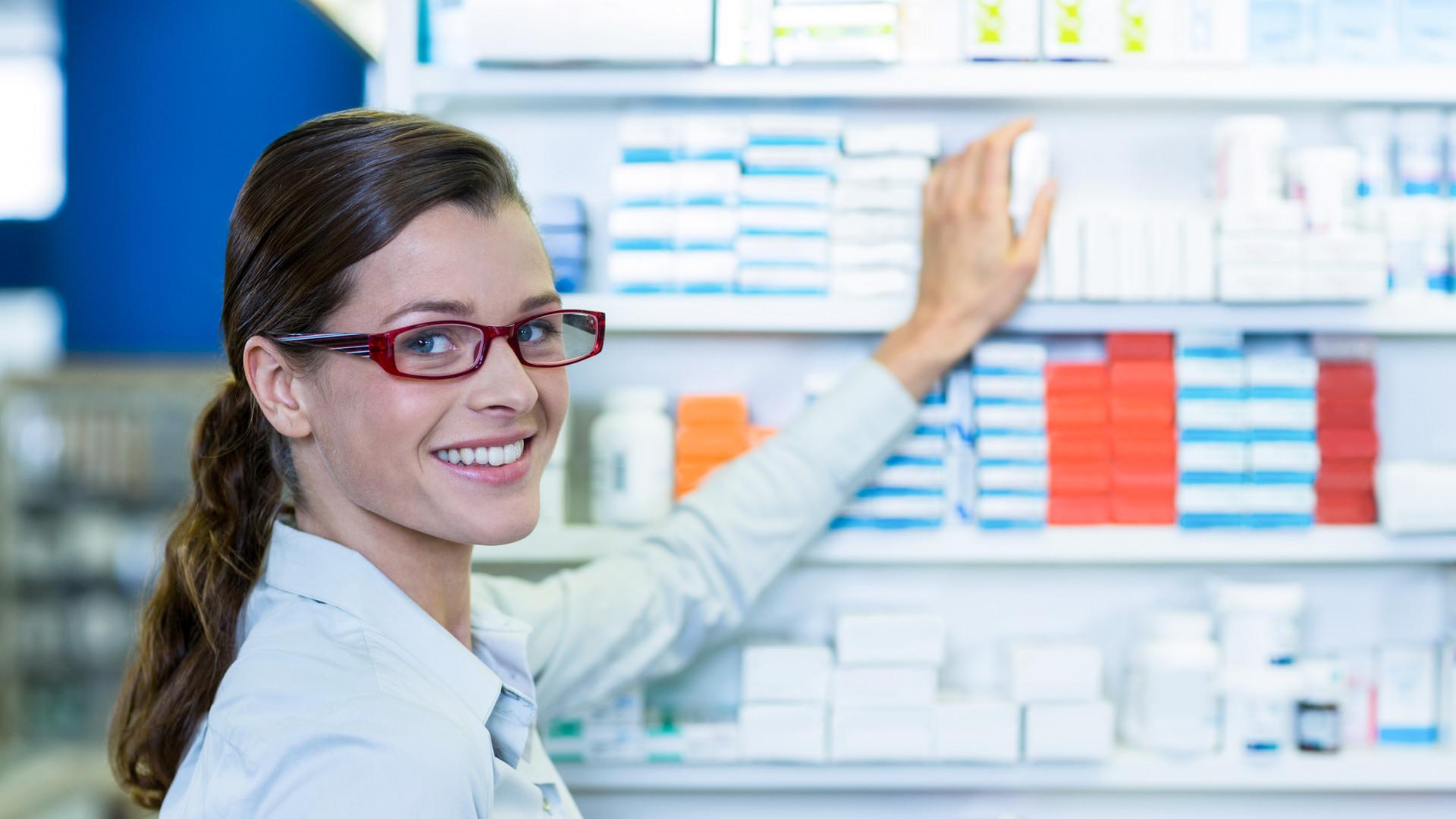 pharmacist-holding-prescription-while-ch