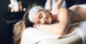 massage-therapist-massaging-woman-B5MQ79