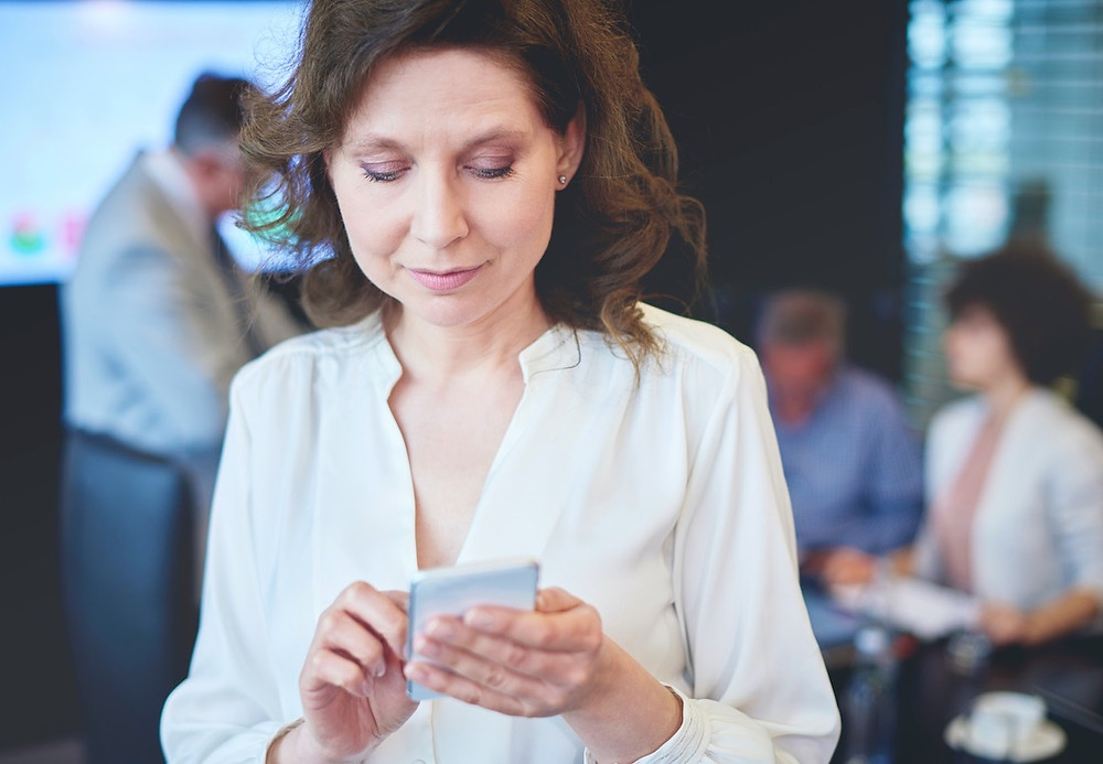 Woman turning off social media notifications