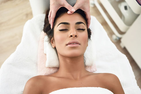 woman-receiving-head-massage-in-spa-well