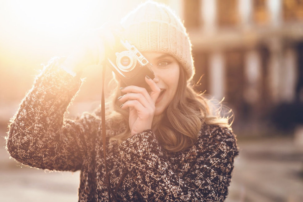 inspired-female-photographer-working-in-sunny-even-P2DN25U_edited.jpg