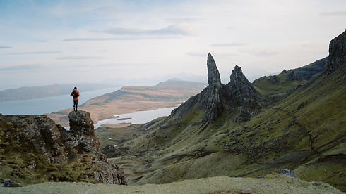 Young man climbing victoriously, Isle of Skye, Scotland