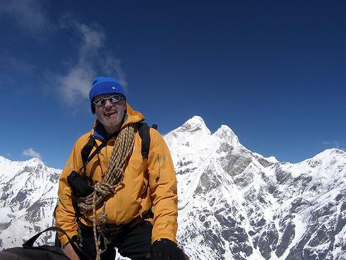 Martin Moran standing infront of Nanda Devi, Himalaya