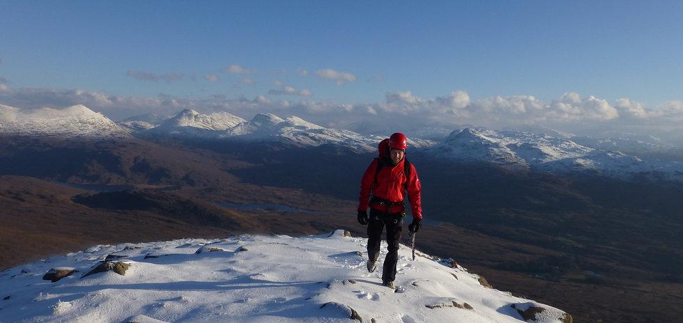 Mountaineer on Chioch of Beinn Bhan Ridge in winter, Scotland