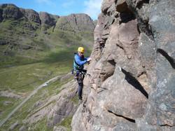 Martin Moran climbing on rock face