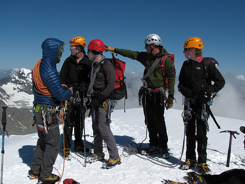 Group of young people receiving mountaineering instruction