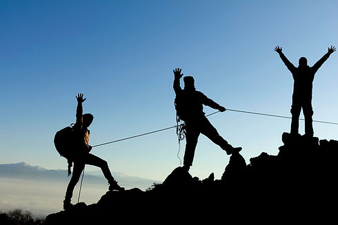 Group of mountaineers climb with rope