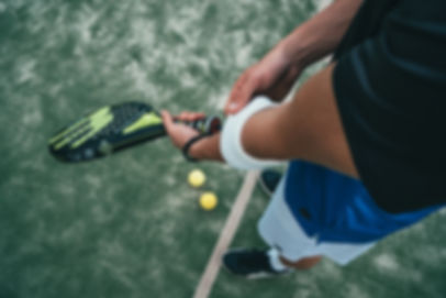 person-holding-black-and-green-tennis-ra