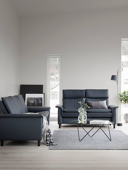 Modern and inviting. The tight but extremely soft cushioning of the Stressless® Aurora gives the sofa a distinct and modern look. Despite the clear lines it also got some nice details giving it an exclusive appeal. The sofa comes in a high back and a low back version, of course with individually adjustable seats to fit your personal requirements. Choose between steel or wooden legs in three different heights. The Stressless® Aurora sofa design is available in multiple versions, leathers, and sizes, customize your own today at Furniture Solutions in Appleton, WI.