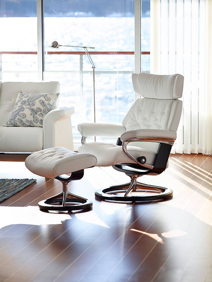 Modern and traditional. That's what we sought out when designing the Stressless® Skyline. It gets its distinctive looks from a retro-inspired, yet modern cushion design. The sitting experience matches any Stressless®, and looks after your whole body. The comfortable neck-rest can be adjusted up to 4 inches to support users with a longer back. The Stressless® Skyline recliner design is available in multiple versions, leathers, and sizes, customize your own today at Furniture Solutions in Appleton, WI.