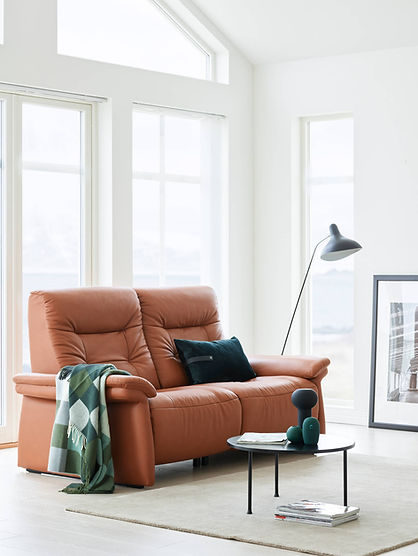 With its gentle curves and generous look, the Stressless® Mary sofa is designed and built for a lifetime of comfort. Its cushioning is extra supple and comfortable, offering a soft landing after a hard day. All seat modules can be delivered with motorized adjustment of back and leg support. Stressless® Mary matches exquisitely with our Stressless® Mayfair recliner, which has been one of our best-selling designs through the decades. Choose between a classic upholstered armrest or an armrest with wooden details for an elegant touch. The Stressless® Mary sofa design is available in multiple versions, leathers, and sizes, customize your own today at Furniture Solutions in Appleton, WI.