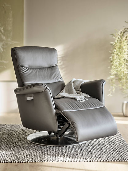 Stressless® Mike is a slimline relaxer with rounded shapes and details that enhances the soft lines of the clean and contemporary cushion design. This modern rocker recliner welcomes you with soft and calming rocking motions as you sit down. The headrest, back and footrest can be adjusted individually to suit your preference. The control panel also has a master button, allowing you to automatically recline into a comfortable resting position. The Stressless® Mike recliner design is available in multiple versions, leathers, and sizes, customize your own today at Furniture Solutions in Appleton, WI.