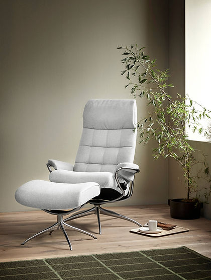 A swingin' armchair. Stressless® London is inspired by the swinging 60's and has got all the potential of becoming a true classic. That 60's feel is combined with the unmatched Stressless® comfort you've come to expect. It is available as both high and low back, and the matching footstool gives your feet some well-deserved comfort. The Stressless® London recliner design is available in multiple versions, leathers, and sizes, customize your own today at Furniture Solutions in Appleton, WI.