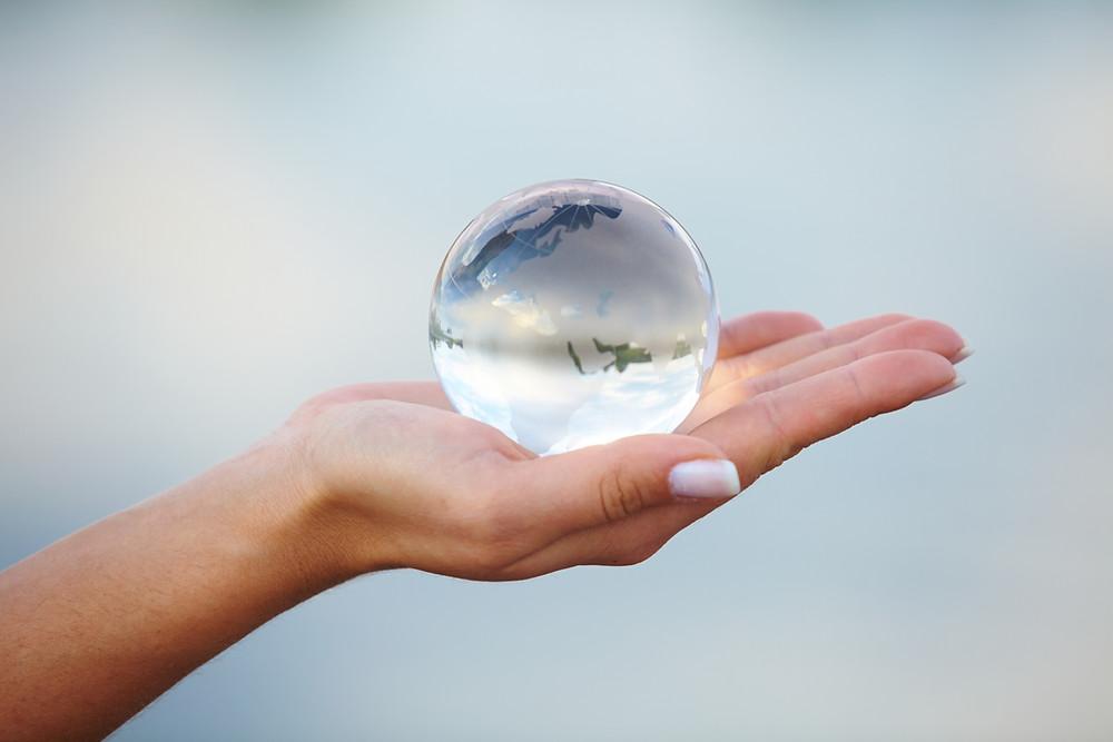 Crystal ball on a hand