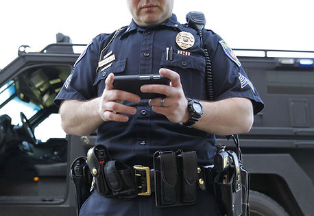 Police Officer using Police Detail Tracking System