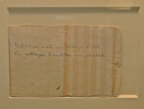 The piece of the wallpaper from the cellar room of the Ipatiev House with the pencil inscription quoting Heine's poem.