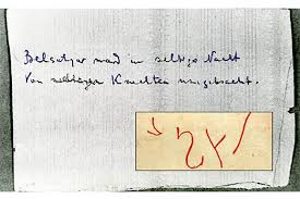 The lines from Heine's poem and the symbol/unknown inscription.