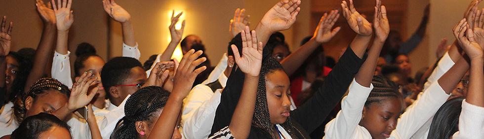 Youth worshipping and praying