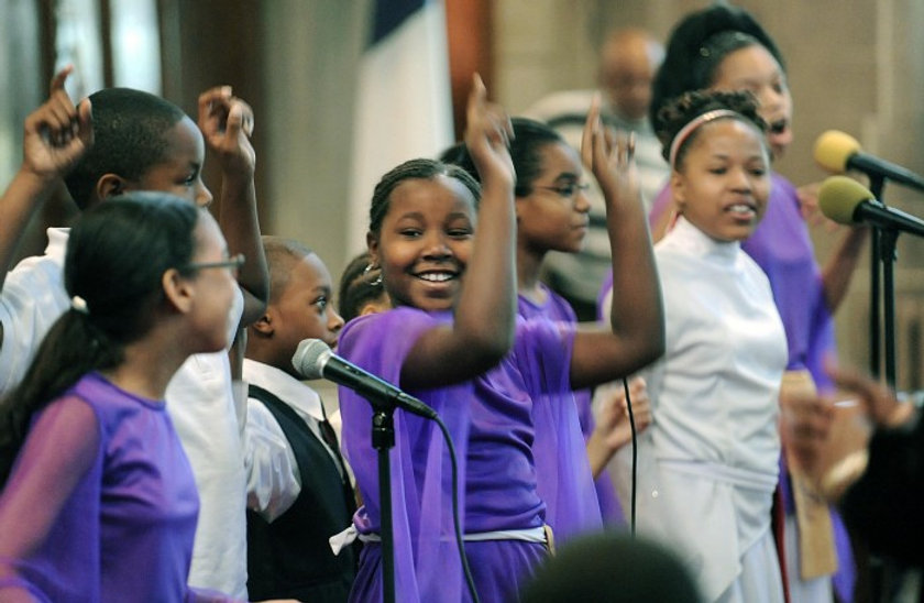 Children singing and worshipping
