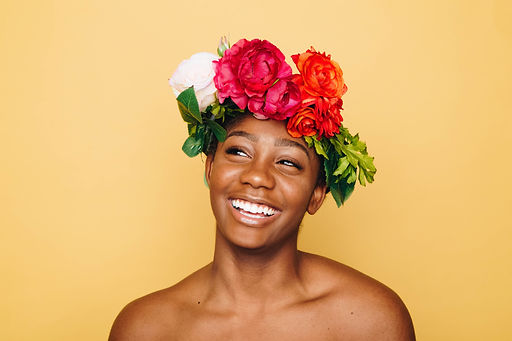 Girl smiling wearing a flower wreath