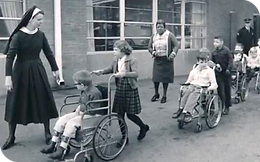 Nuns and teachers outside with students at the Cerebral Palsy School of Louisville.