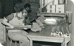 A young man and women work with machinery at the Highlands Opportnunity Workshop.