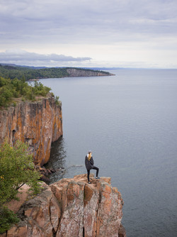 girl on cliff by conner-bowe