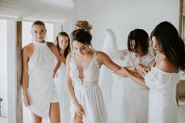 Bride preparation with bridesmaid