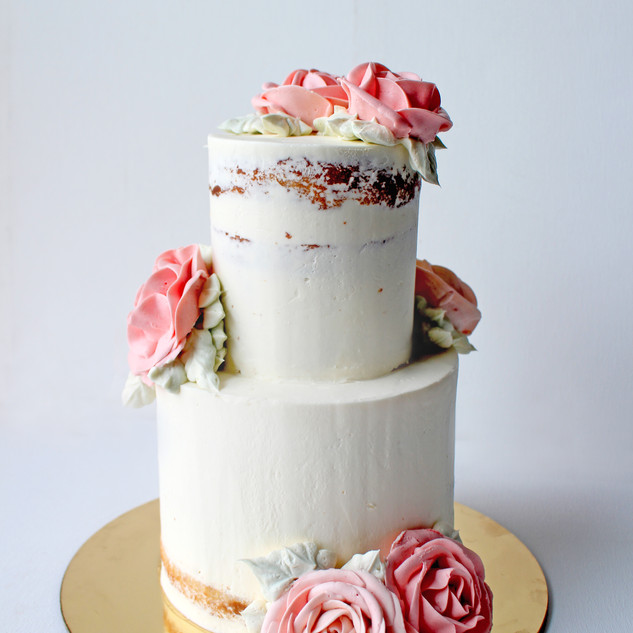 Semi naked mini 2 tier cake with buttercream roses