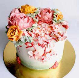 Buttercream Cherry blossom, rose, and peony flower cake