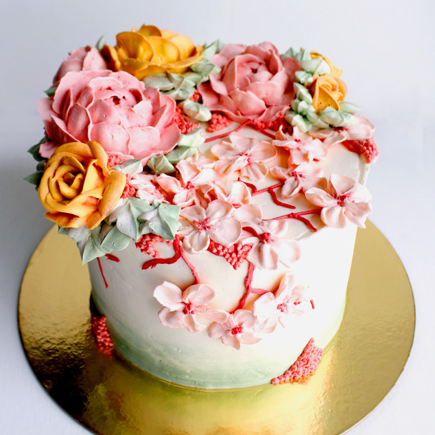 Buttercream Cherry blossom, rose, and peony flower cake