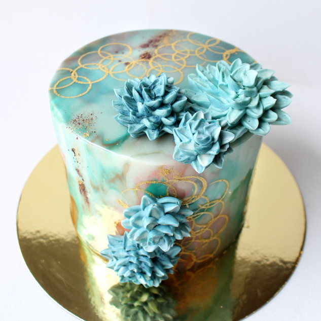 Mirror glaze cake with buttercream piped succulents
