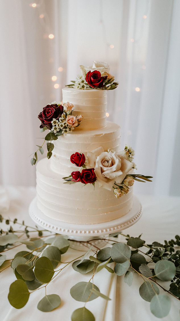 Textured buttercream wedding cake with fresh flowers