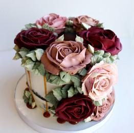 Semi naked cake with buttercream roses