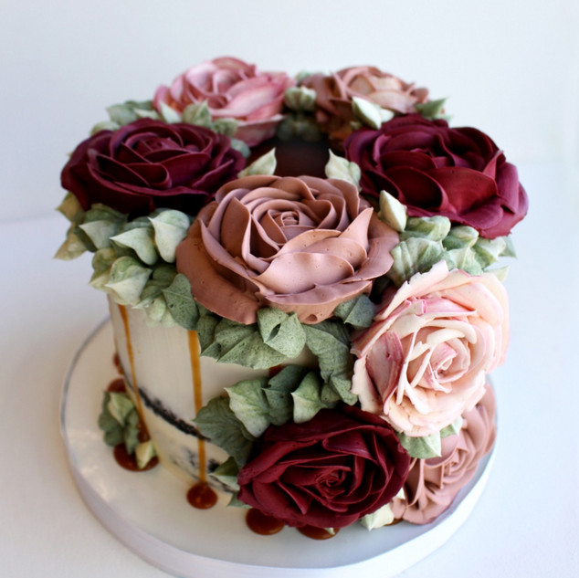 Semi naked cake with buttercream roses