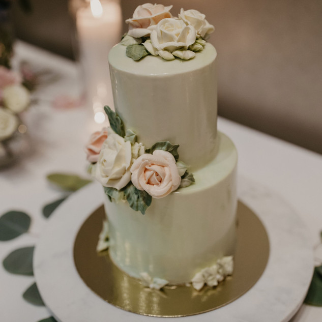 Mini wedding cake with buttercream flowers and sage mirror glaze