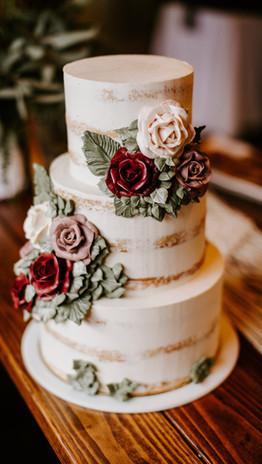 Semi naked wedding cake with buttercream flowers