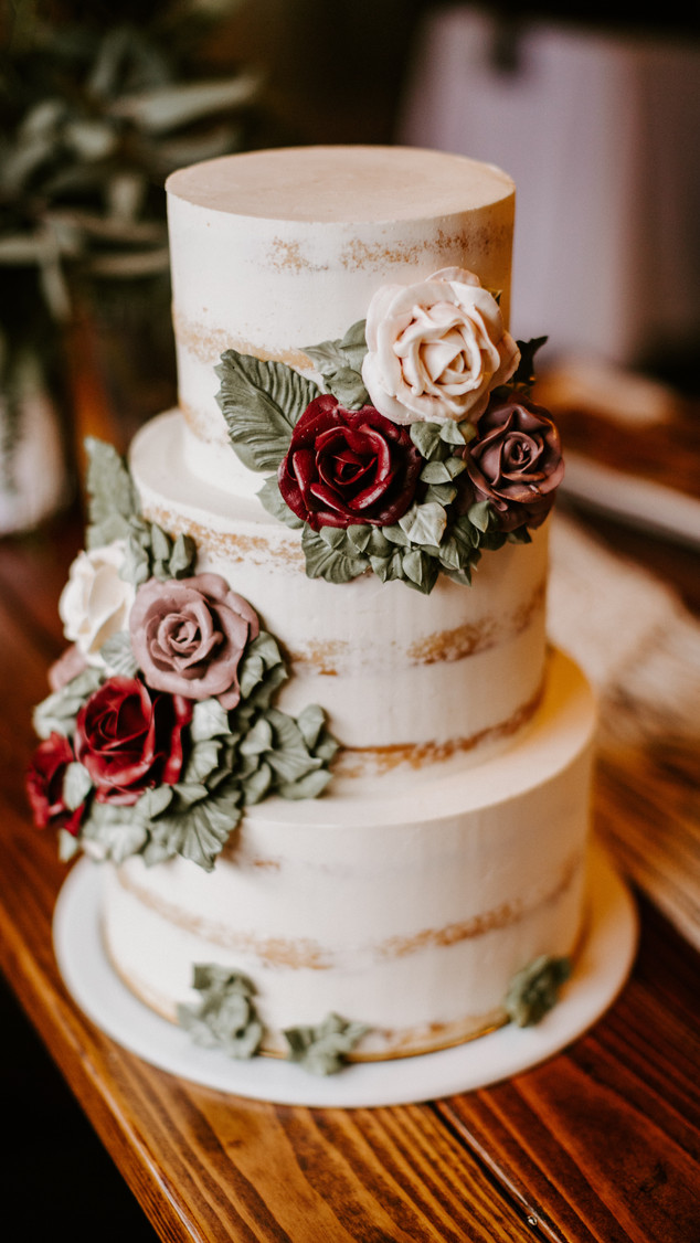 Semi naked wedding cake with buttercream flowers